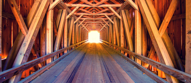 Light at the end of the tunnel, Inside wood covered bridge in Maine USA.