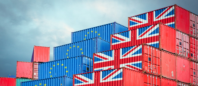 Cargo containers with European Union and British flags reflecting Brexit and restrictions in export and import