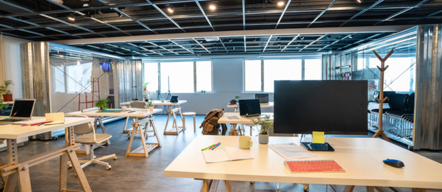 Interior of modern, empty co-working space with office supplies