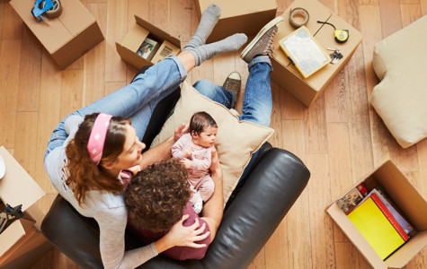 Millennial Parents moving to a new flat. Lifestyle shot in real location, Spain.