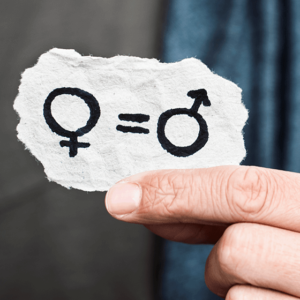 Hands holding paper showing female sign equals male sign