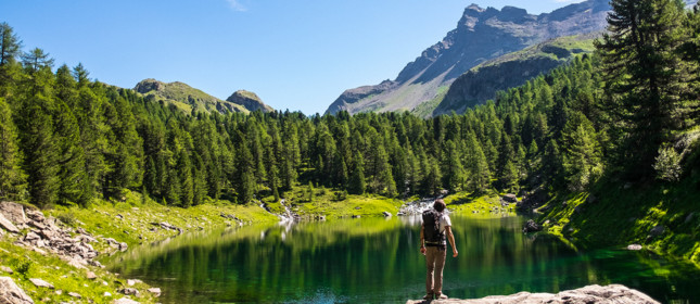 Hiker in looking at lake and mountains