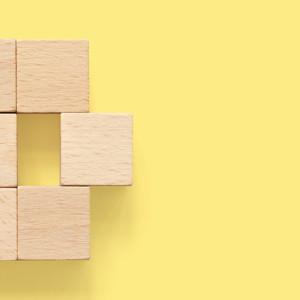 wooden blocks on yellow background
